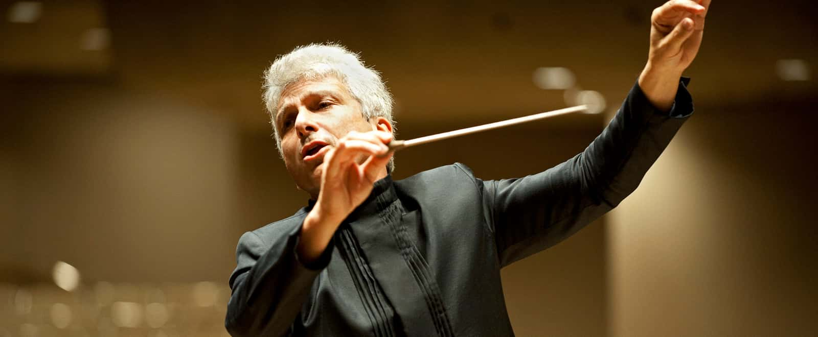 Orchestra conductor in black suit