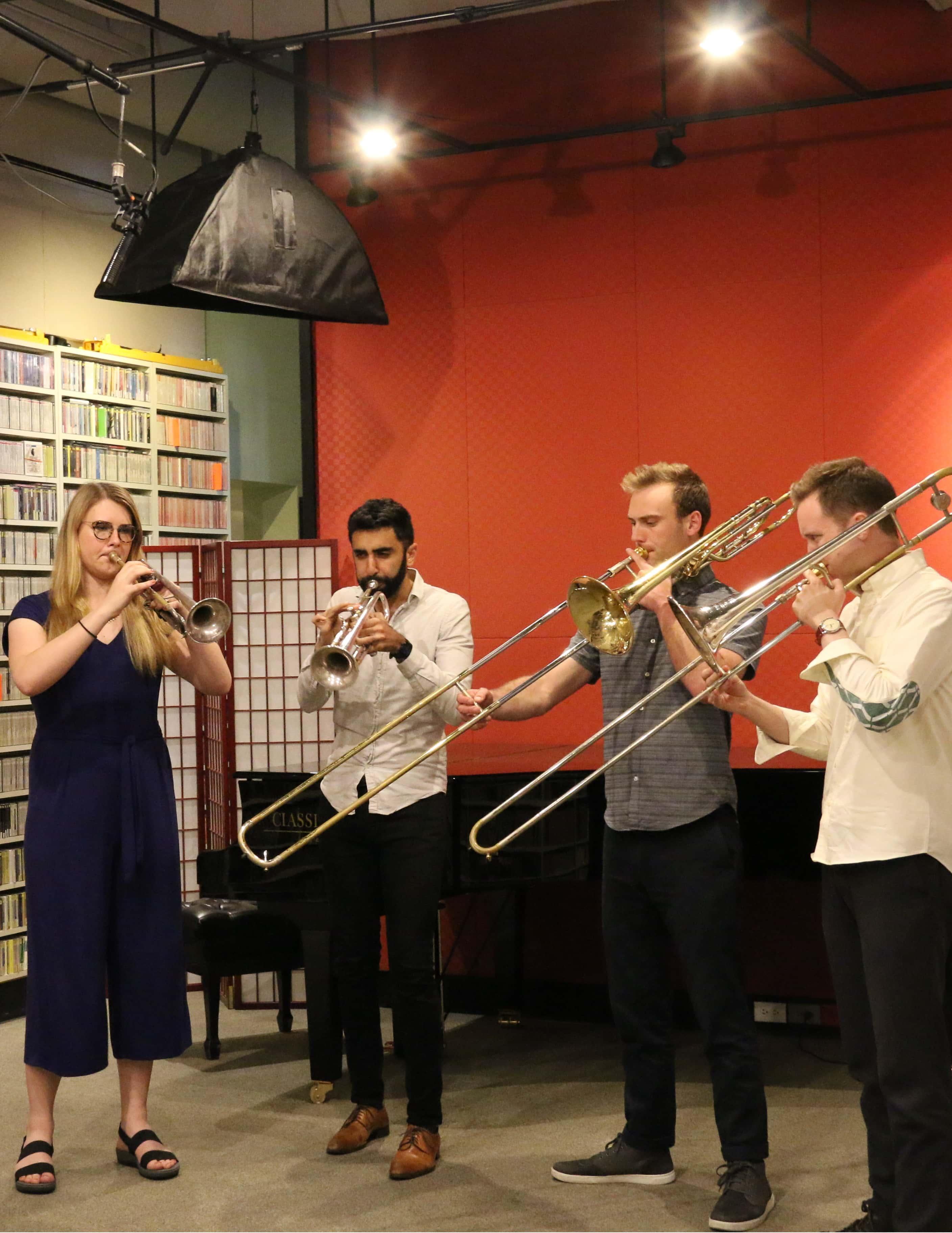 Brass quartet performs inside radio station