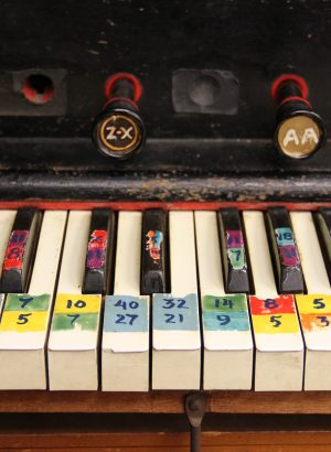 Close-up of piano keys with colorful markings on the keys