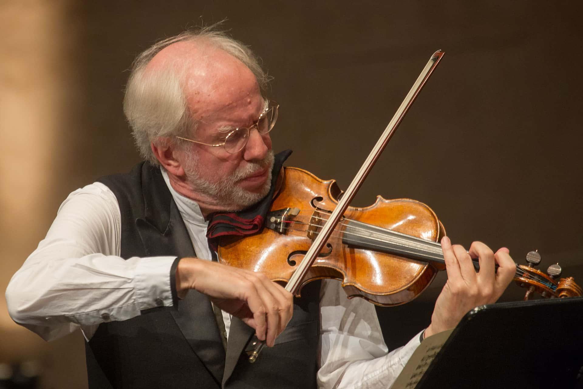 Man plays a violin