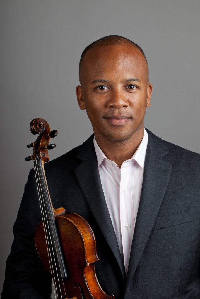 Portrait of man in suit jacket holding violin