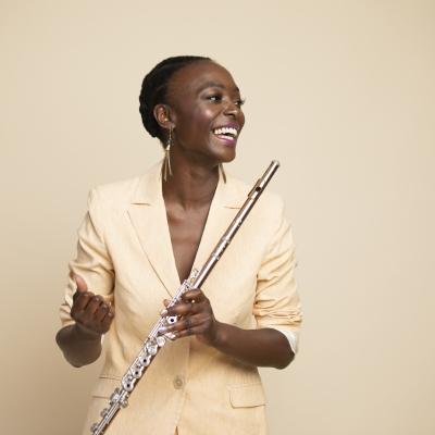 Portrait of woman holding flute