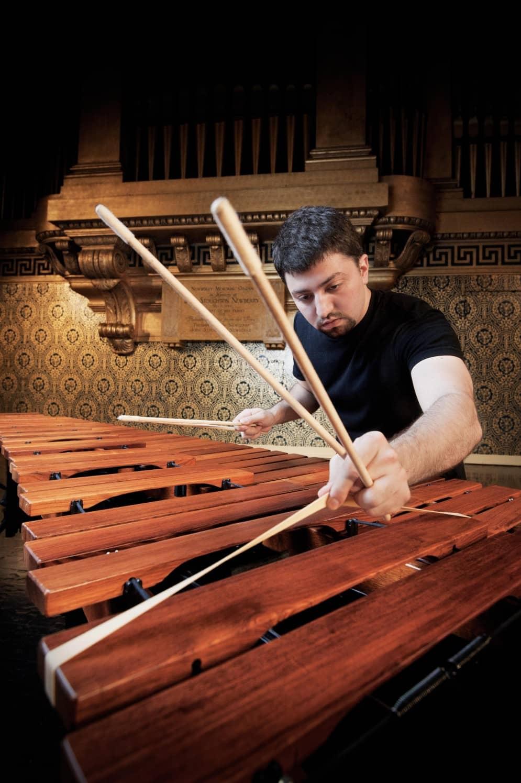 Musician plays a marimba.