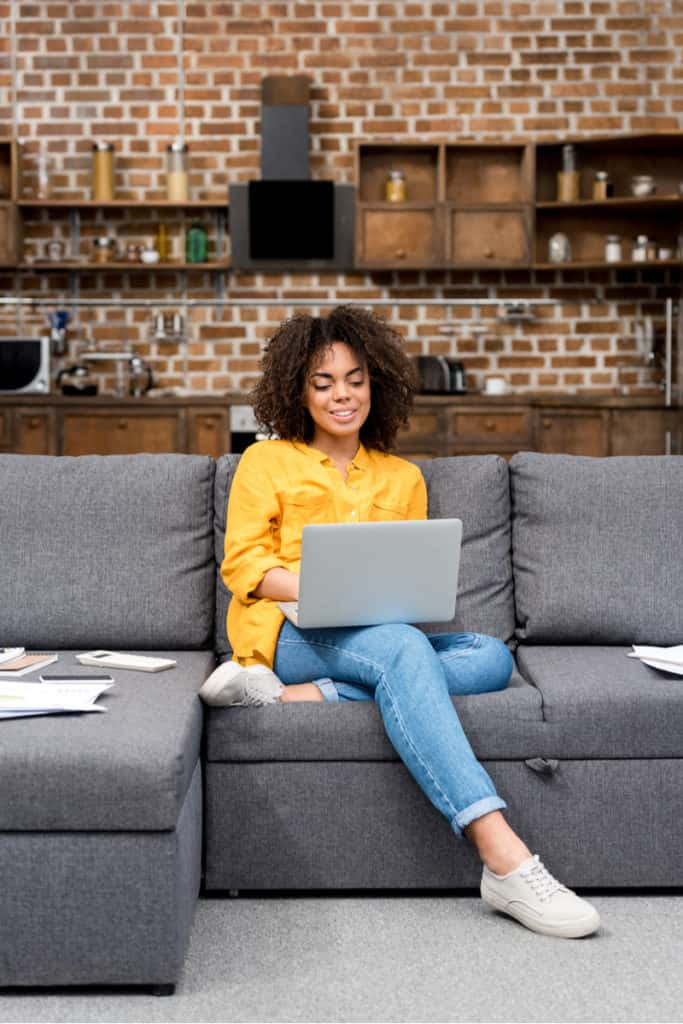 woman sitting on a couch working from home