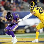 Baltimore Ravens vLos Angeles Rams: LOS ANGELES, CALIFORNIA - NOVEMBER 25:  Wide receiver Marquise Brown #15 of the Baltimore Ravens catches his second touchdown in the first quarter of the game against the Safety Taylor Rapp #24 of the Los Angeles Rams  at Los Angeles Memorial Coliseum on November 25, 2019 in Los Angeles, California. (Photo by Sean M. Haffey/Getty Images)