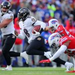Baltimore Ravens vBuffalo Bills: ORCHARD PARK, NEW YORK - DECEMBER 08: Lamar Jackson #8 of the Baltimore Ravens runs with the ball during the first half against the Buffalo Bills in the game at New Era Field on December 08, 2019 in Orchard Park, New York. (Photo by Brett Carlsen/Getty Images)