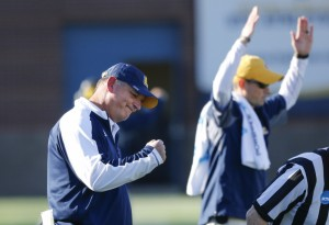 University of Tennessee at Chattanooga head coach Russ Huesman celebrates as defensive back Montrell Pardue's 99-yard fumble return for a touchdown is confirmed in review during an NCAA college football game against Weber State, Saturday, Nov. 26, 2016, in Chattanooga, Tenn. (Doug Strickland/Chattanooga Times Free Press via AP) ORG XMIT: TNCHA204