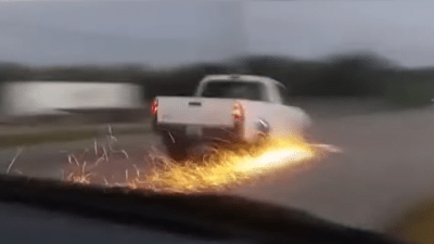 Truck on road with sparks
