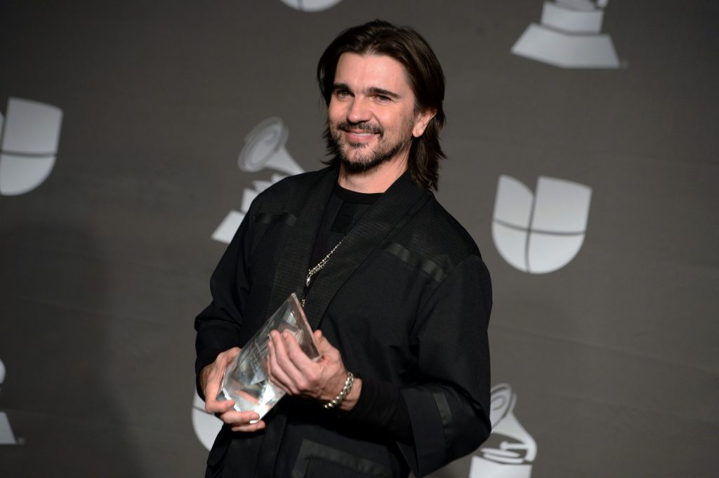 Recipient of the Person of the Year award Colombian musician Juanes poses in the press room during the 20th Annual Latin Grammy