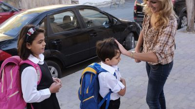 Mom saying bye to kid returning to school