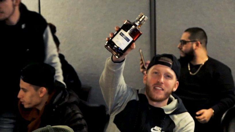 Drewski Holding A Martell Bottle