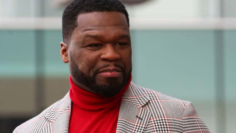 50 Cent wearing red turtle neck