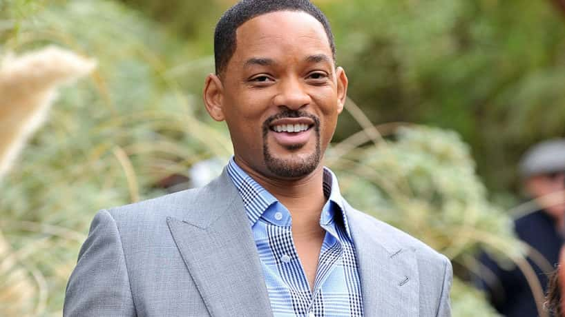 Will Smith smiling at the camera