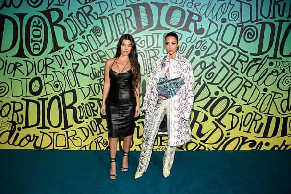 MIAMI, FLORIDA - DECEMBER 03: Kourtney Kardashian and Kim Kardashian West attend the Dior Men's Fall 2020 Runway Show on December 03, 2019 in Miami, Florida