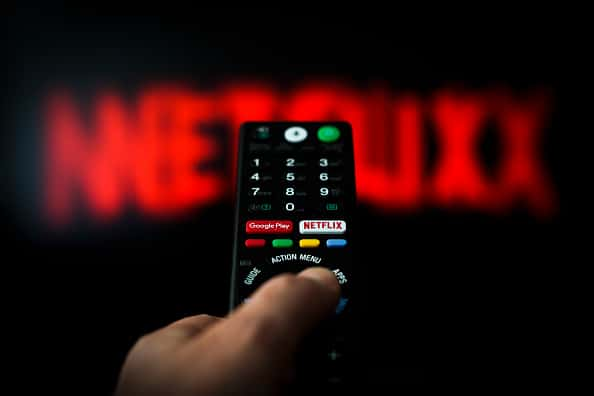 A button for launching the Netflix application is seen on a remote control in this photo illustration in Warsaw, Poland on April 25, 2019. According to an article published in the Wall Street Journal Netflix has been causing a decrease in sexual activity especially amongst millennials.