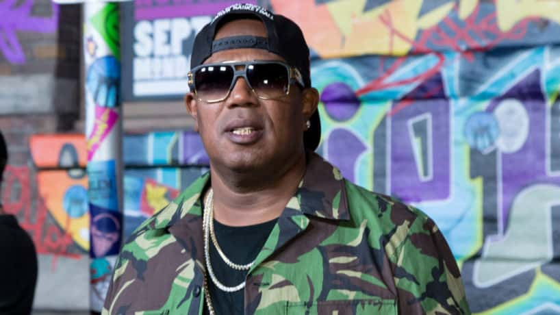 Master P. wearing green and sunglasses