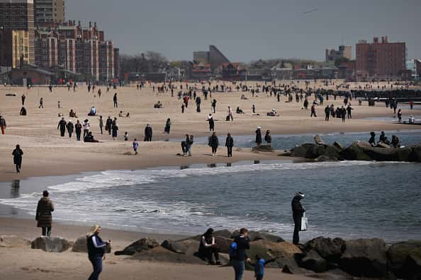 People keep their personal distance as they enjoy a spring afternoon at Brooklyn's Coney Island on April 25, 2020 in New York City. New York City, which has been the hardest hit city in America from COVID-19, is starting to see a slowdown in hospital visits and a lowering of the daily death rate from the virus.