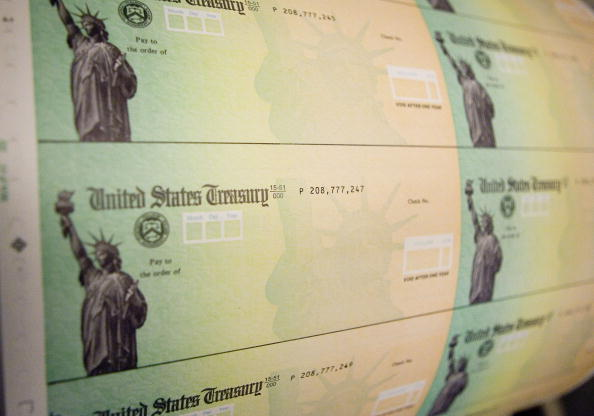 Economic stimulus checks are prepared for printing at the Philadelphia Financial Center May 8, 2008 in Philadelphia, Pennsylvania. One hundred and thirty million households are eligible to receive a tax rebate check under the $168 billion economic stimulus plan.