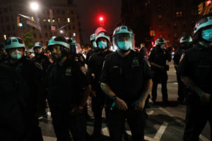 Police officers wearing shields of armor during the protest