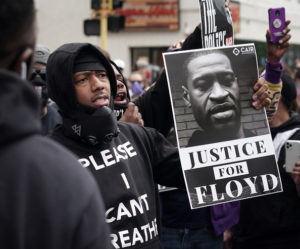 Minneapolis, MN May 29: Peaceful protesters, including Actor and comedian Nick Cannon celebrated the memory of George Floyd and demanded justice outside the Cup Foods store on Chicago Avenue in South Minneapolis where Floyd died at the hands of police.