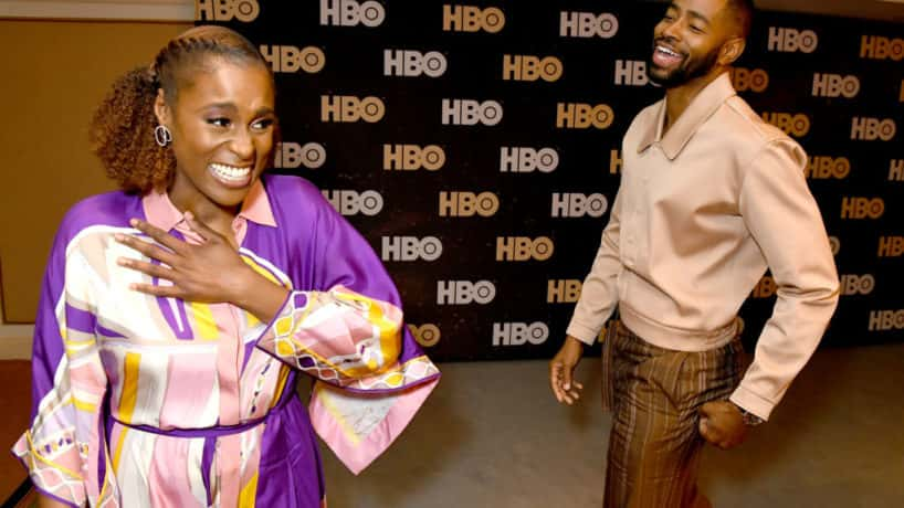 Issa Rae and Jay Ellis laughing