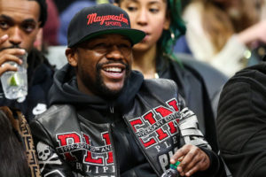 Floyd Mayweather smiling in the picture