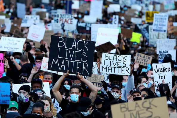 BOSTON, MASSACHUSETTS - MAY 31: Demonstrators protest in response to the recent death of George Floyd on May 31, 2020 in Boston, Massachusetts. Protests spread across cities in the U.S., and in other parts of the world in response to the death of African American George Floyd while in police custody in Minneapolis, Minnesota.