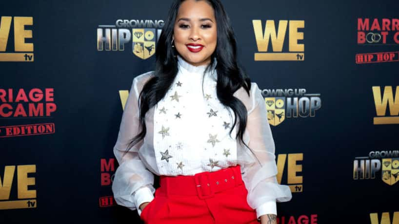 Tammy Rivera smiling at the camera wearing red and white