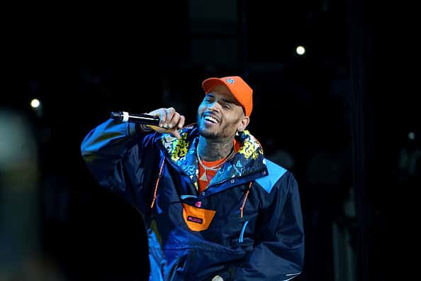 Chris Brown performs onstage at the 2017 Hot for the Holidays concert at Prudential Center on December 14, 2017 in Newark, New Jersey.