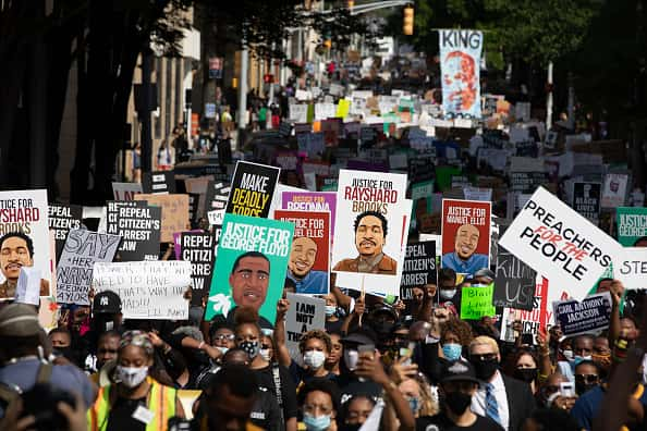 Protesters take part in the March On Georgia, organized by NAACP, on June 15, 2020 in Downtown Atlanta, Georgia. The march comes in response to the police killing of Rayshard Brooks outside an Atlanta Wendy's restaurant on June 12.