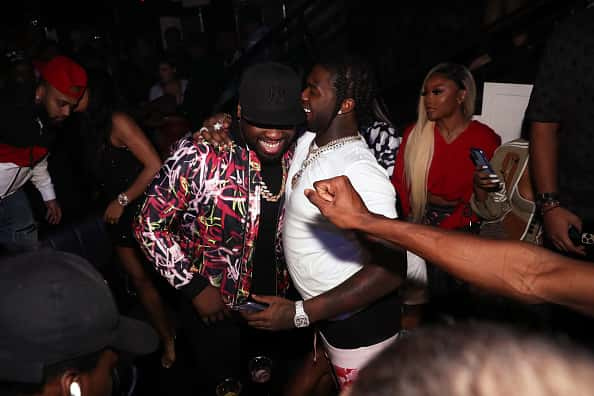 50 Cent (L) and Pop Smoke attend Trey Songz & 50 Cent Host The Big Game Weekend 2020 at Cameo on February 01, 2020 in Miami, Florida.