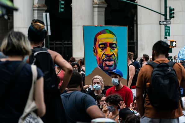 A portrait of George Floyd is seen during a protest encampment on June 28, 2020 in a park near City Hall in New York City. Demonstrations continue with protests and demands for lawmakers to cut the New York Police Department's (NYPD) budget.