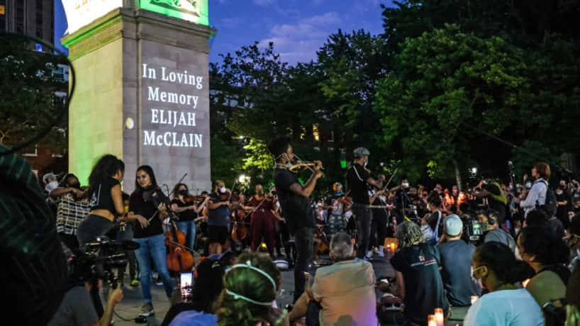 NEW YORK, NY - JUNE 29: String players perform during a violin vigil for Elijah McClain in Washington Square Park on June 29, 2020 in New York City. McClain was a 23-year-old African American man who died while in police custody after he was stopped while walking home in Aurora, Colorado last August.