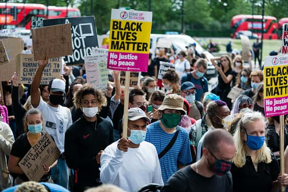 Protesters holding placards during a Black Lives Matter protest in London, following the death of George Floyd who died in police custody in Minneapolis, London, Britain, July 5, 2020.