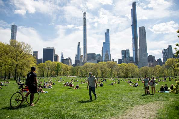 People wearing masks observe social distancing in Central Park as temperatures rise amid the coronavirus pandemic on May 3, 2020 in New York City. COVID-19 has spread to most countries around the world, claiming over 248,000 lives with over 3.4 million cases.