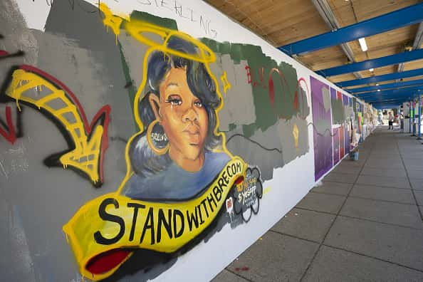 A mural for Breonna Taylor is painted on a construction fence near the White House in Washington, D.C., U.S., on Sunday, June 14, 2020. Atlanta Police Chief Erika Shields resigned Saturday after an officer fatally shot a black man the night before in a Wendy's parking lot.