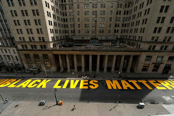 "A mural reading ""Black Lives Matter"" in large yellow letters was added to the street in front of the Brooklyn Municipal Building on June 30, 2020 in New York City. The Brooklyn Municipal Building houses the Department of Probation and Department of Finance in addition to several other city offices. Joralemon street was also recently co-named Black Lives Matter Boulevard. New York City aims to have Black Lives Matter murals painted in all five boroughs."