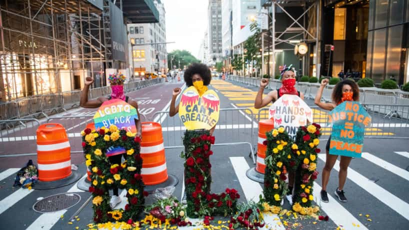 NEW YORK, NEW YORK - JULY 12: Models pose for a photo at a Black Lives Matter fashion show and protest by fashion designer Jason Christopher Peters in front of Trump Tower on Fifth Avenue on July 12, 2020 in New York City.