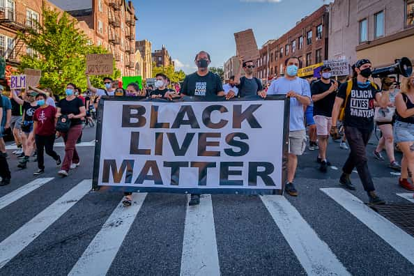2020/07/12: A crowd od counterprotesters marching behind a Black Lives Matter banner at the protest. Pro-NYPD marchers clashed with a big crowd of Black Lives Matter counterprotesters during the ìBack the Blueî rally and march in Bay Ridge, Brooklyn.