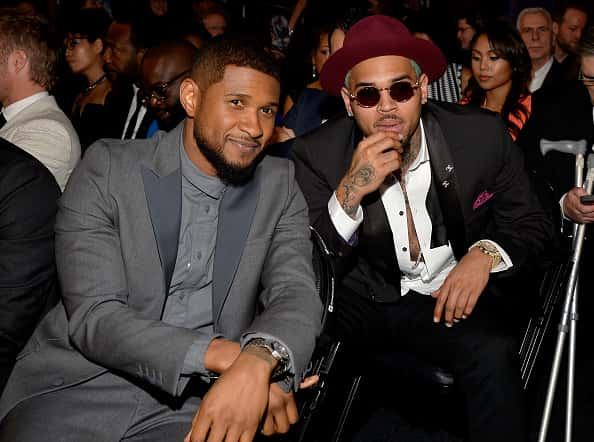 LOS ANGELES, CA - FEBRUARY 08: Recording artists Usher (L) and Chris Brown during The 57th Annual GRAMMY Awards at the STAPLES Center on February 8, 2015 in Los Angeles, California.