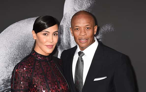Music producer Dr. Dre (R) and wife Nicole Young attend the premiere of HBO's 'The Defiant Ones' at Paramount Theatre on June 22, 2017 in Hollywood, California.