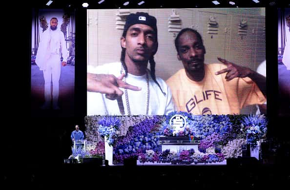 Snoop Dogg speaks onstage during Nipsey Hussle's Celebration of Life at STAPLES Center on April 11, 2019 in Los Angeles, California. Nipsey Hussle was shot and killed in front of his store, The Marathon Clothing, on March 31, 2019 in Los Angeles.