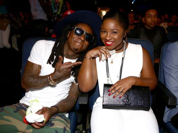 LOS ANGELES, CA - JUNE 29: Rapper Lil Wayne (L) and Reginae Carter attend the BET AWARDS '14 at Nokia Theatre L.A. LIVE on June 29, 2014 in Los Angeles, California.