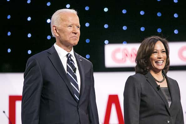 2020 Democratic Presidential Candidates former U.S. Vice President Joe Biden, left, and Senator Kamala Harris, a Democrat from California, stand on stage during of the Democratic presidential candidate debate in Detroit, Michigan, U.S., on Wednesday, July 31, 2019. Hillary Clinton in 2016 was the first Democratic presidential candidate to lose the state of Michigan in 28 years, by a slim 11,000 votes. The party seems to understand it can't take Michigan for granted this time around.