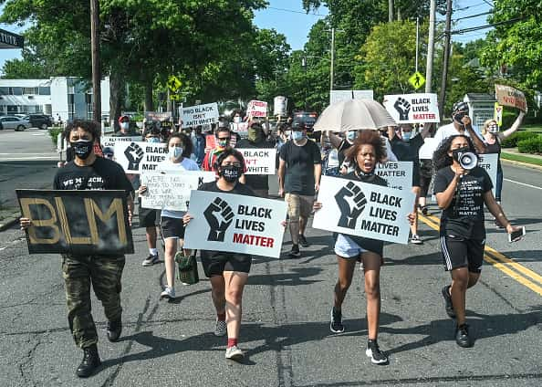 Amityville, N.Y.: Protestors march against racism and police brutality on Broadway in Amityville, New York on on July 5, 2020.