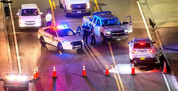 JACKSONVILLE, FL - AUGUST 26: A heavy police presence remains into the night at the shooting outside Jacksonville Landing on August 26, 2018 in Jacksonville, Florida. A shooting rampage during a Madden 19 video game tournament at the site claimed four lives, with several others wounded, according to published reports.