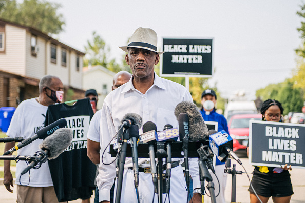 KENOSHA, WI - AUGUST 24: Eric Russell, president of the Tree of Life Justice League, speaks to press on August 24, 2020 in Kenosha, Wisconsin. A night of civil unrest occurred after the shooting of Jacob Blake, 29, on August 23. Blake was shot multiple times in the back by Wisconsin police officers after attempting to enter into the drivers side of a vehicle.