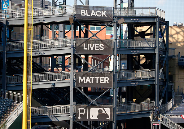 Black Lives Matter banners are seen in the left field rotunda during the Opening Day game between the Pittsburgh Pirates and the Milwaukee Brewers at PNC Park on July 27, 2020 in Pittsburgh, Pennsylvania. The 2020 season had been postponed since March due to the COVID-19 pandemic.