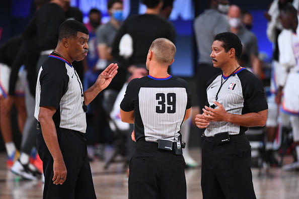 Referees, Tony Brothers, Tyler Ford and Bill Kennedy share a conversation during the game between the Houston Rockets and the Oklahoma City Thunder Round One, Game Four of the NBA Playoffs on August 24, 2020 at the The Arena in Orlando, Florida. NOTE TO USER: User expressly acknowledges and agrees that, by downloading and/or using this Photograph, user is consenting to the terms and conditions of the Getty Images License Agreement. Mandatory Copyright Notice: Copyright 2020 NBAE
