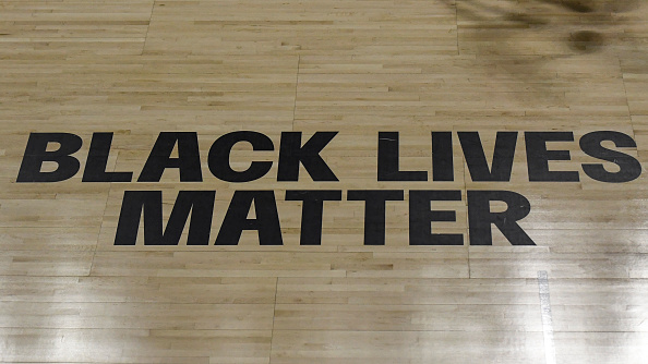 General view of the shadow of a player dribbling a ball on the court past the Black Lives Matter sign on the court during the second half of the game between the Atlanta Dream and the Minnesota Lynx at Feld Entertainment Center on August 23, 2020 in Palmetto, Florida. NOTE TO USER: User expressly acknowledges and agrees that, by downloading and or using this photograph, User is consenting to the terms and conditions of the Getty Images License Agreement.